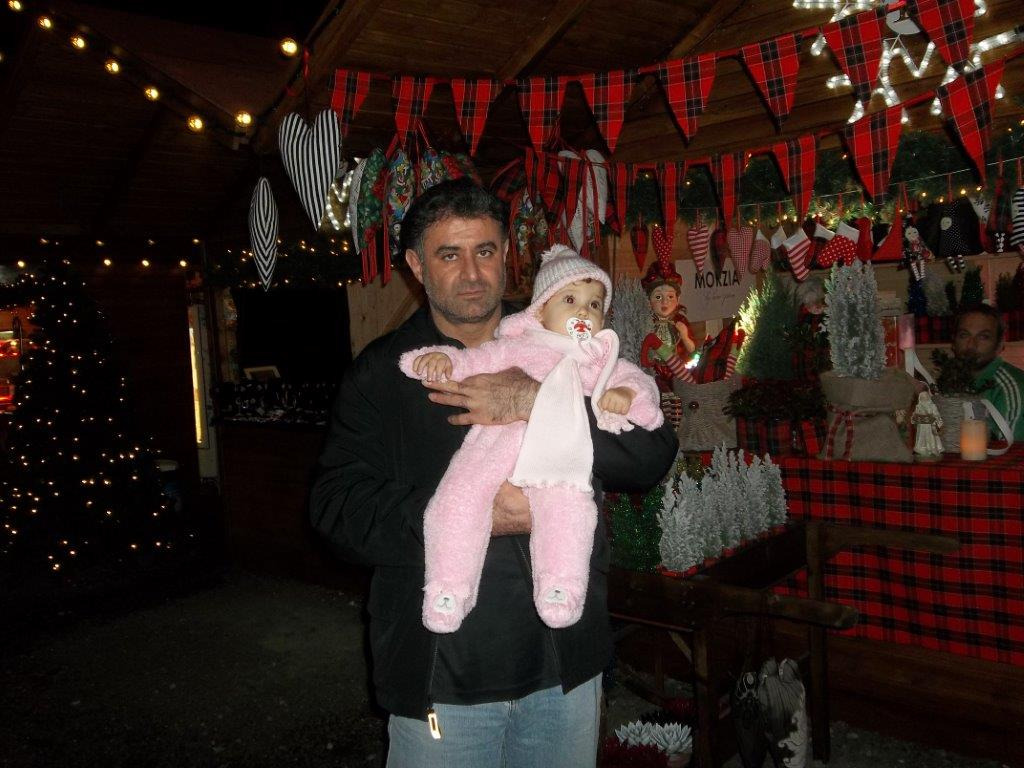 Gloria Travel Services operations director with baby in Limassol Christmas village, Cyprus 2014